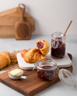 High view croissant and homemade wild berry jam