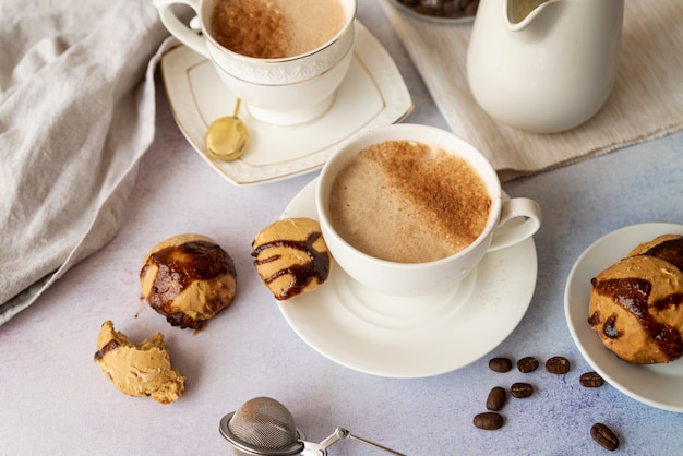 High view of cup of coffee and sweets