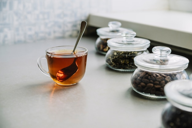 High view of cup of tea and herbs