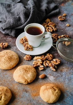 High view of cup with cookies and walnuts