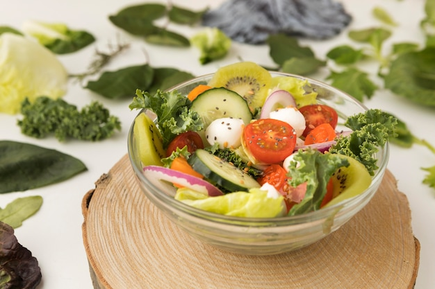 High view delicious salad in transparent bowl