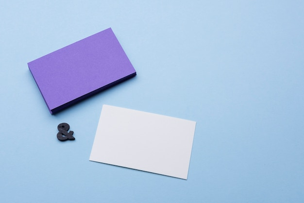 High view empty violet and white business cards