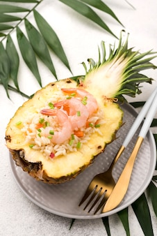 High view half of pineapple with seafood