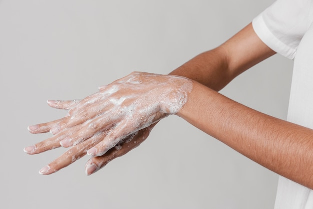 High view hygiene concept washing hands with soap