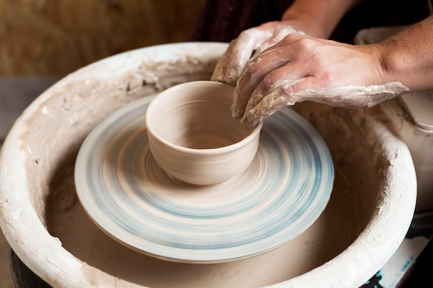 High view modeling of clay on a potter's wheel