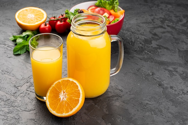 High view of orange juice in glasses