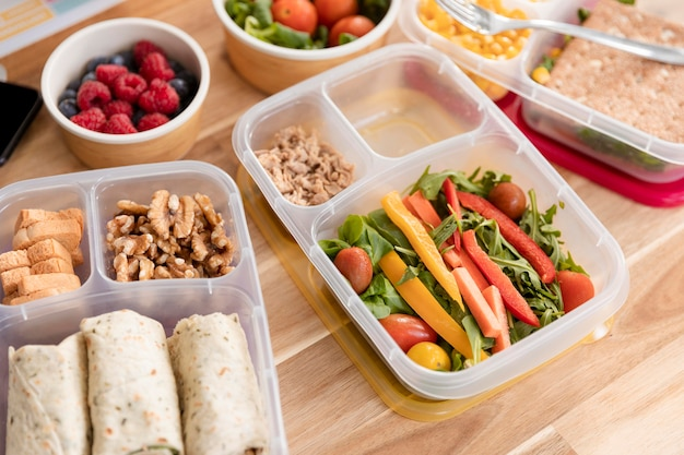 High view organic food in lunch boxes