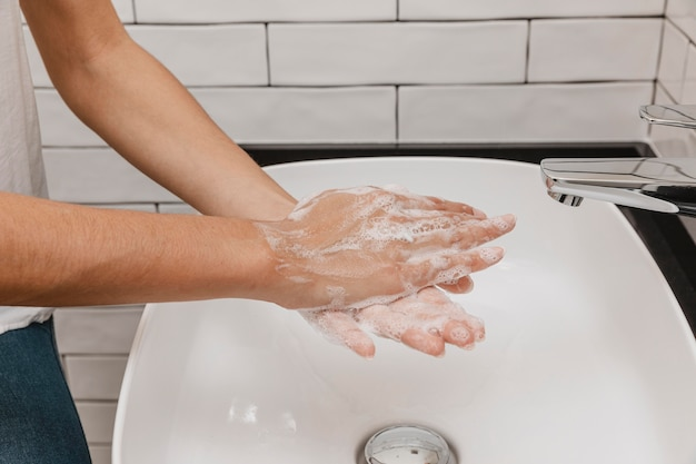 High view person washing hands