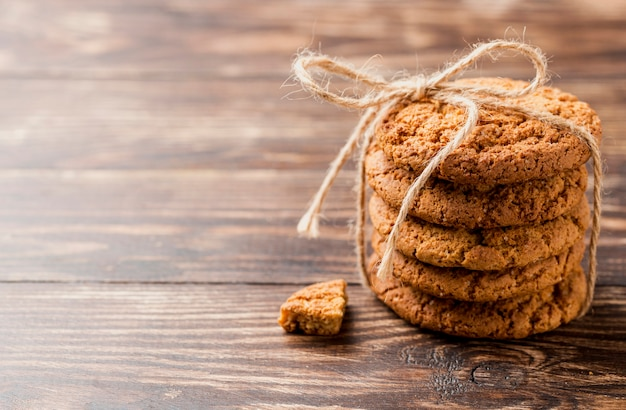High view pile of biscuits with string