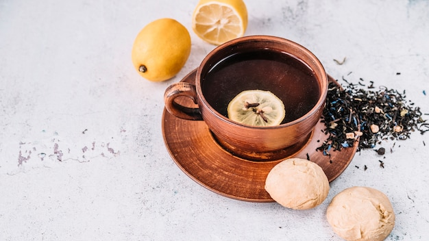 High view rustic cup of tea and lemons