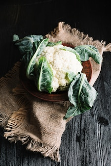 High view shot of cauliflower on a burlap fabric