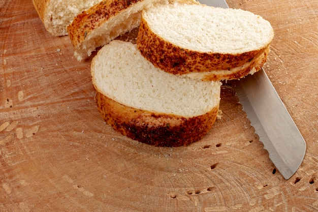 High view of sliced bread and knife