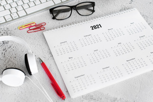 High view stationery 2021 calendar and reading glasses