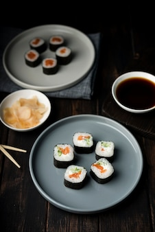 High view sushi rolls on plates and chips