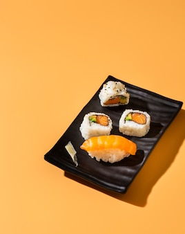 High view sushi rolls with nigiri