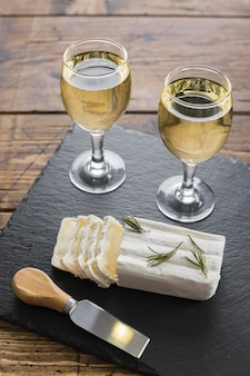 High view white wine glasses and cheese
