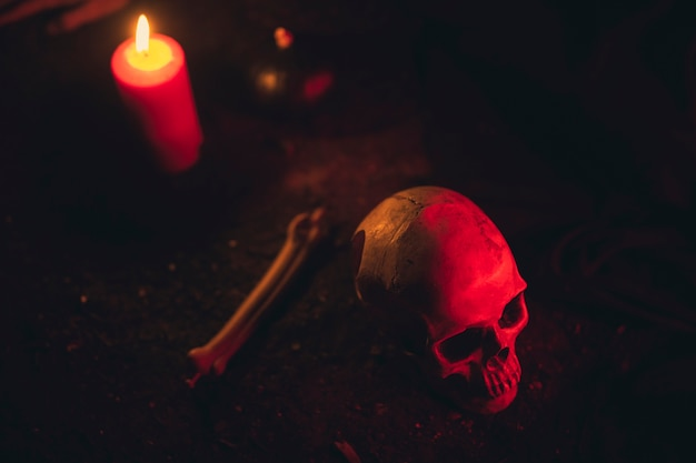 High view of witchcraft arrangement with candles and skull