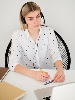 High view woman learning a course from home
