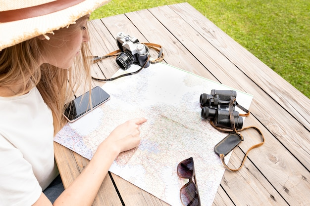 High view of woman looking at map