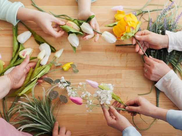 High view women hands with spring flowers