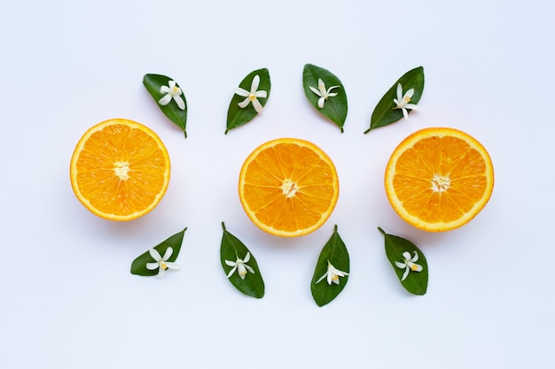 High vitamin c. fresh orange citrus fruit with leaves and flower on white