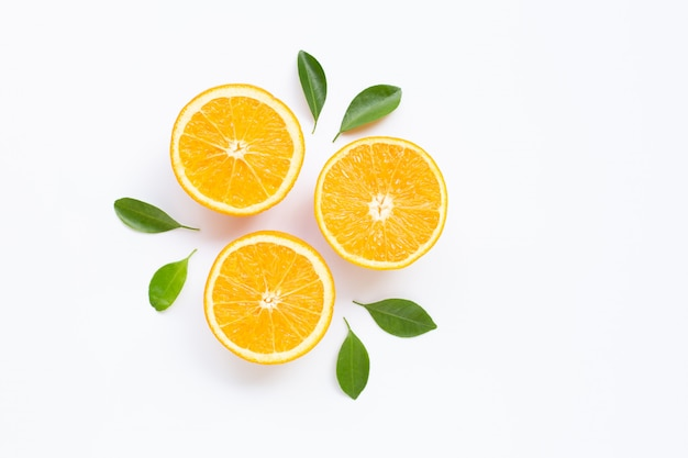 High vitamin c. fresh orange citrus fruit with leaves isolated on white surface.