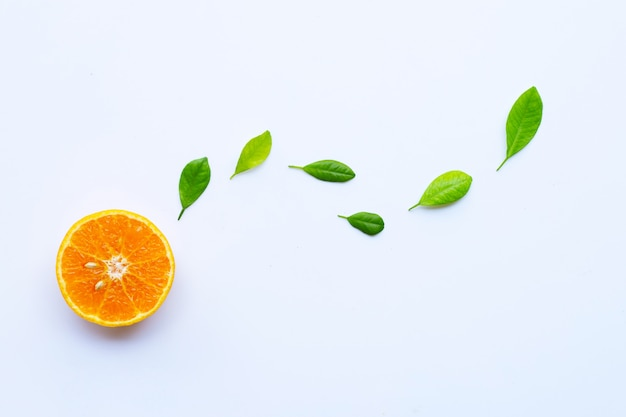 High vitamin c. fresh orange citrus fruit with leaves isolated on white.