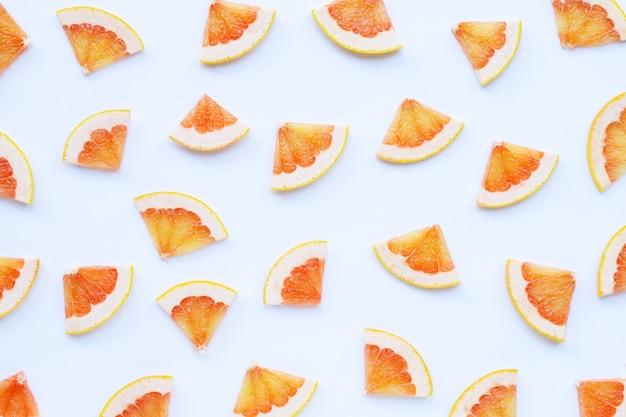 High vitamin c. juicy grapefruit slices on white surface.