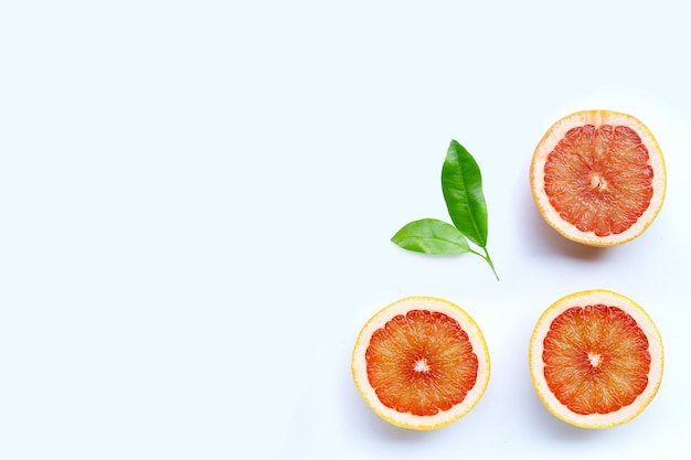 High vitamin c. juicy grapefruit on white background. top view