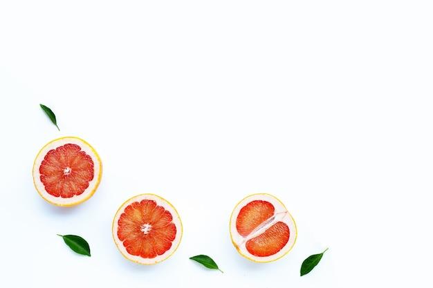 High vitamin c. juicy grapefruit on white wall.