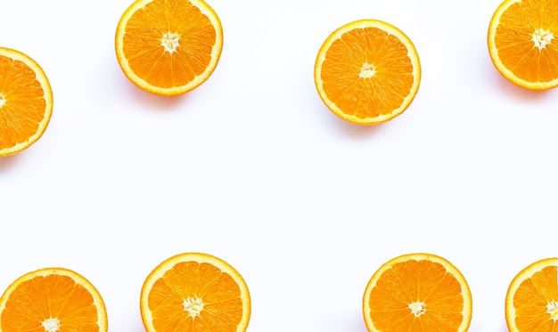 High vitamin c, juicy and sweet. frame made of fresh orange fruit on white background.