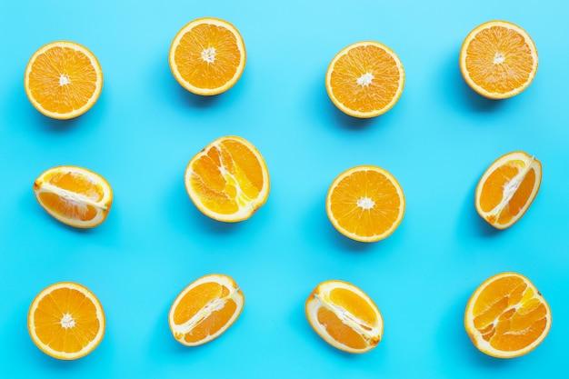 High vitamin c, juicy and sweet. fresh orange fruit  on blue background.