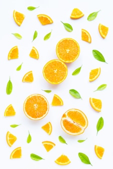 High vitamin c, juicy and sweet, fresh orange fruit with green leaves  on white.