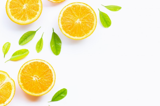 High vitamin c, juicy and sweet. fresh orange fruit with green leaveson white background