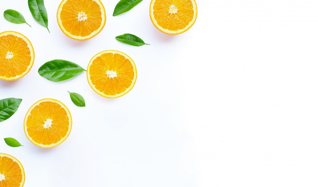 High vitamin c, juicy and sweet. fresh orange fruit with green on white background.