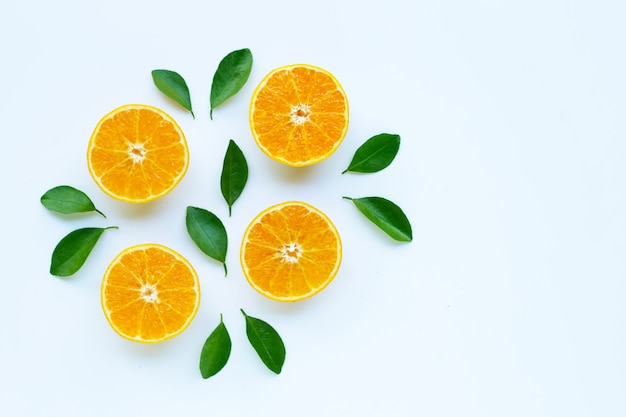 High vitamin c, orange fruits with leaves on white background.
