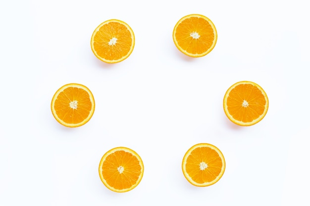 High vitamin c, round frame made of orange fruit on white background.