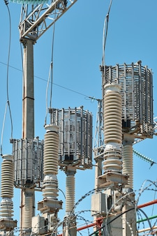 High voltage electrical transformers in an electricity distribution power plant. close-up