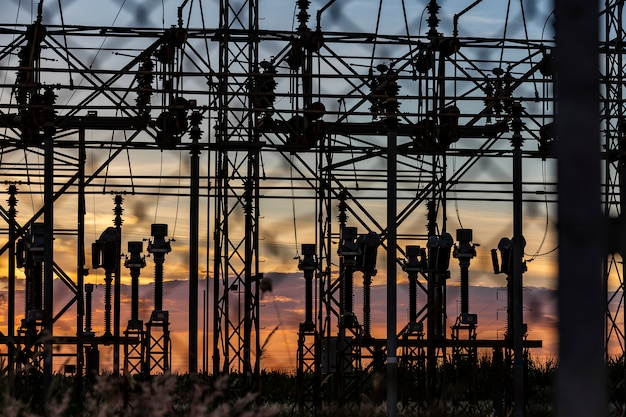 High-voltage lines of electrical distribution stations at sunset
