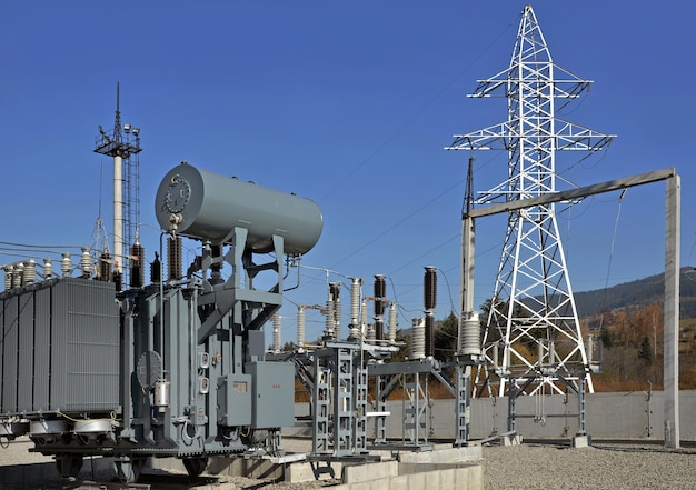 High voltage oil-filled power transformer on electrical substation.