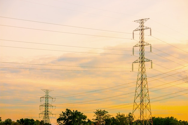High voltage pole and sunset sky