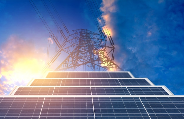 High voltage pole with solar cell on blue sky background for energy and power concept.