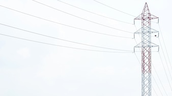 High voltage post.High-voltage tower sky background. Electricity is the major energy