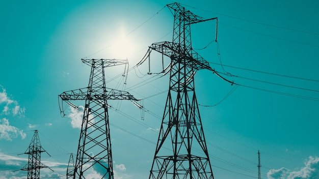 High voltage post high voltage tower sky background highvoltage power lines energy industry producti...