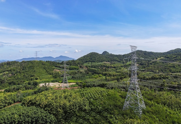 High voltage post, high voltage tower sky background on the mountain forest