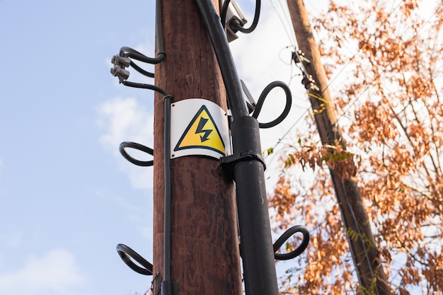 High voltage sign on a pole in outdoor