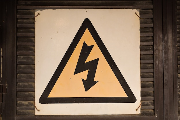 High voltage sign on the wall