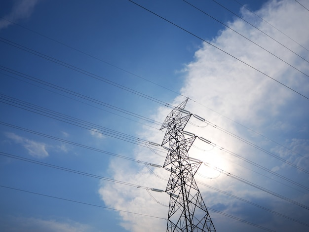 High voltage transmission towers amid the beautiful sky