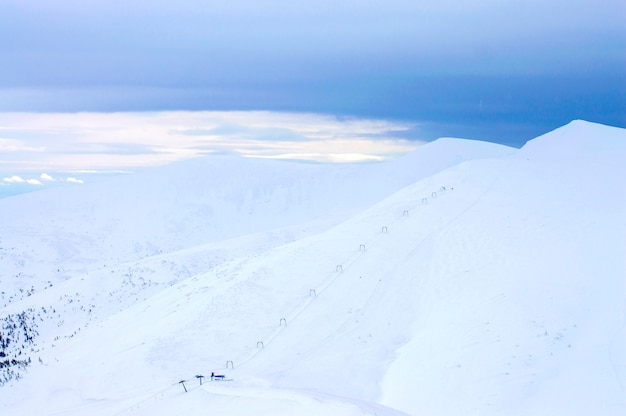 Highlands in winter are shrouded in snow.