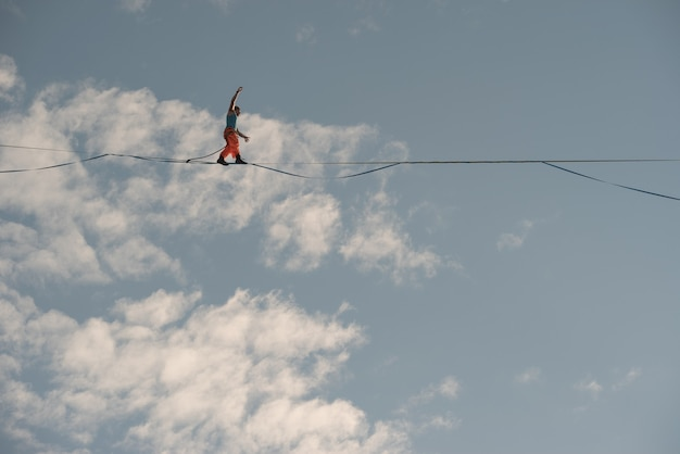 Highliner walks on a tightrope against the backdrop of the firmament.